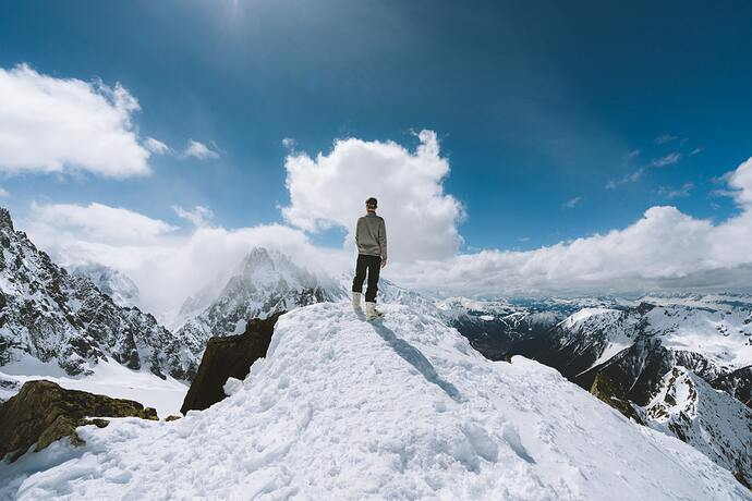 End-Of-The_Month_Challenge-person-standing-on-slope-glacier-mountain-1081111-Simon-Migaj